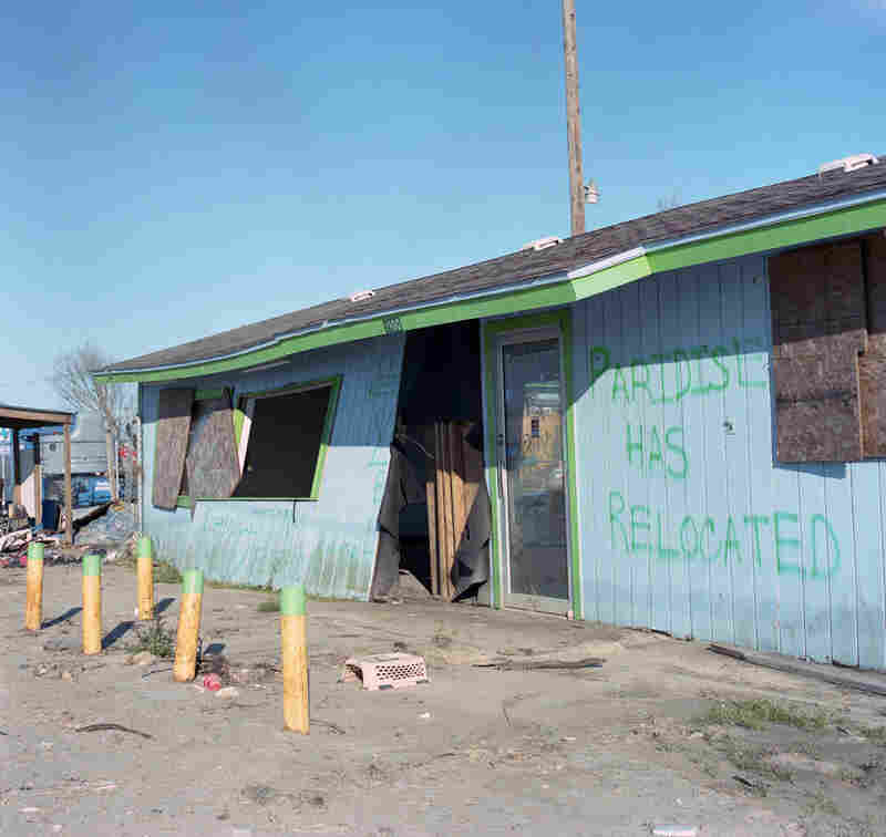 """Graffiti in post-Hurricane Ike Galveston, Texas, inspired the name of Sandy Carson's photo series, """"Paradise Has Relocated."""""""