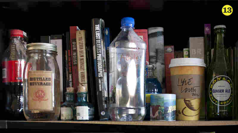 "Musician Souvenirs — Bob, Robin and Stephen are a nostalgic bunch, as you can probably tell from this list. Since there aren't ticket stubs for the Tiny Desk, they often save ""souvenirs"" from their guests. Here, you're looking at Adele's water bottle and Lyle Lovett's coffee. See more in the next photo."