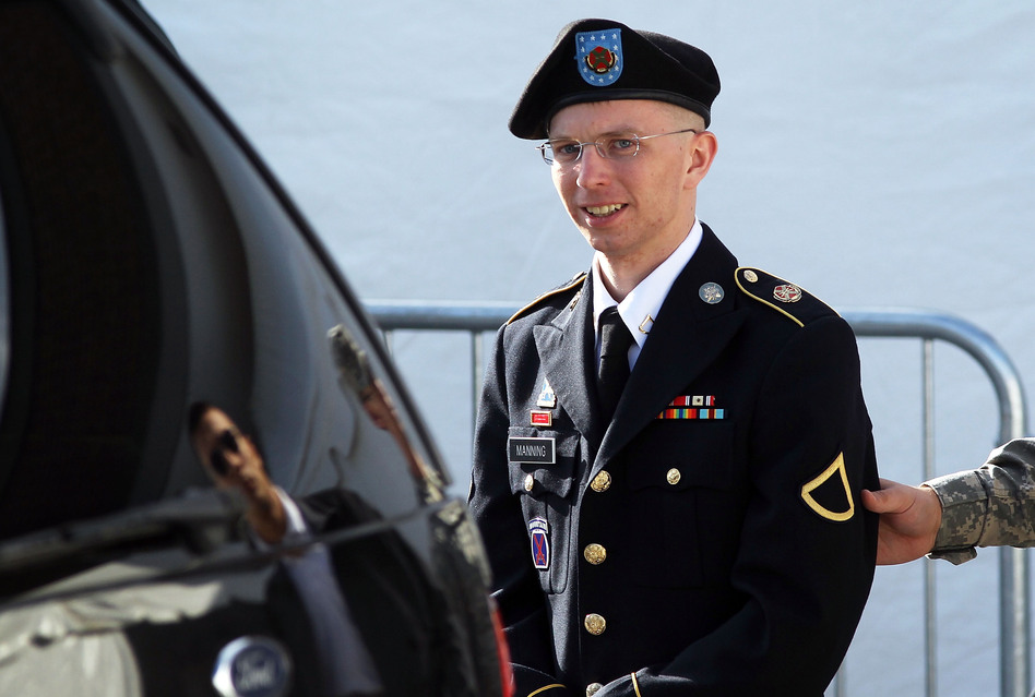 U.S. Army Private Bradley Manning is escorted as he leaves a military court in June. (Alex Wong/Getty Images)