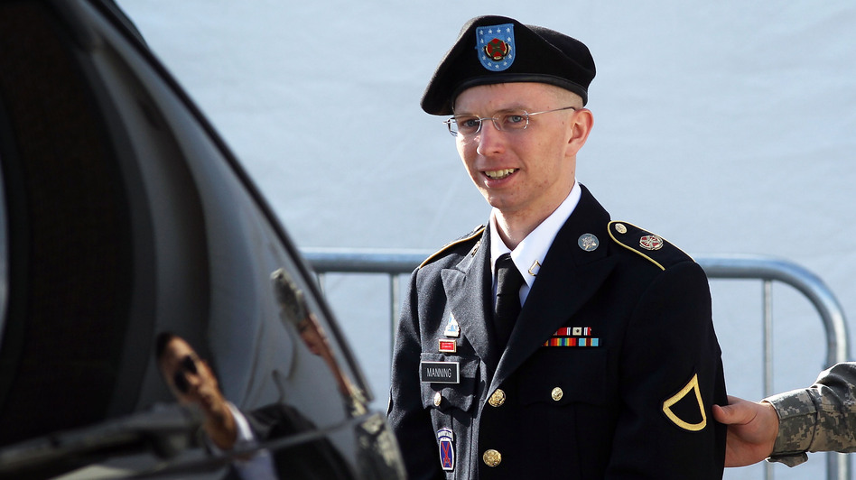 U.S. Army Private Bradley Manning is escorted as he leaves a military court in June. (Getty Images)