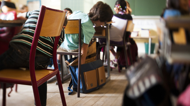 President Francois Hollande argues that homework puts poor children at a disadvantage, but others argue the extra work is needed to help those students succeed. (AFP/Getty Images)