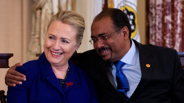 United Nations Aids Executive Director Michel Sibide hugs Secretary of State Hillary Clinton after they they presented the a road map for stopping HIV around the world. (AFP/Getty Images)