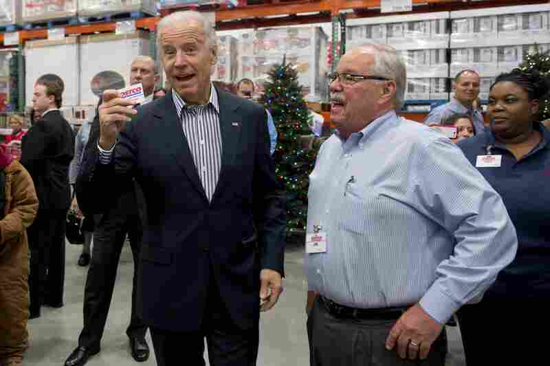 The vice president came prepared with his Costco card. At right: Costco co-founder Jim Sinegal.