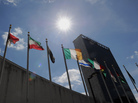 Flags from nations around the world fly outside the U.N. building in New York City. The challenges facing President Obama's foreign policy team will be among the topics of today's national conversation, hosted by Talk of the Nation and the Wilson Center.