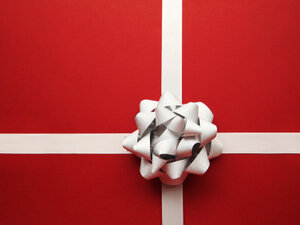 Simple red gift wrap with a silver bow.