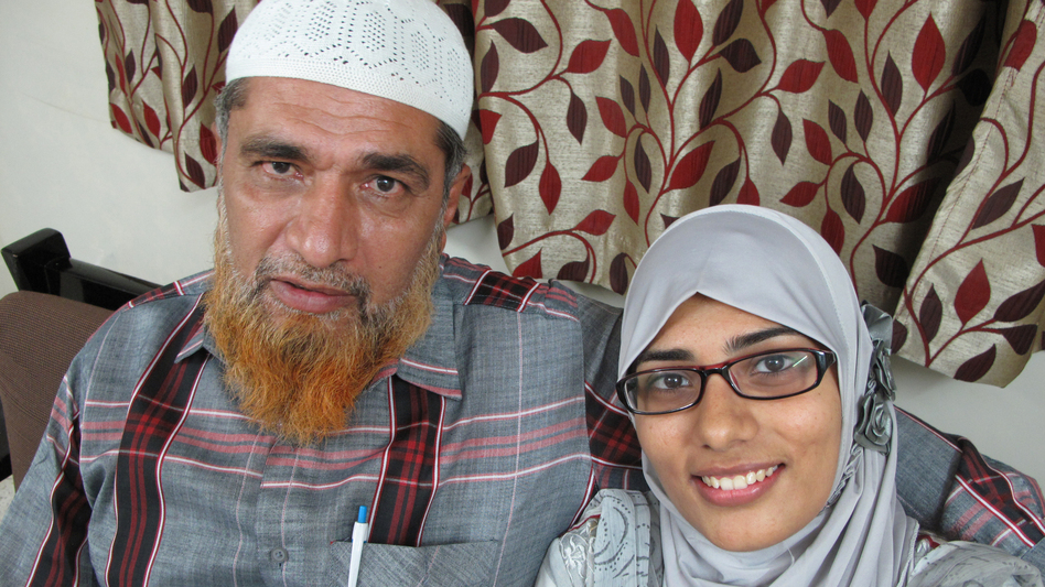 "Shaken by the reaction to his daughter's Facebook post, Farooq Dhada (shown here with Shaheen) says in India, freedom of speech ""exists only on paper."" (NPR)"