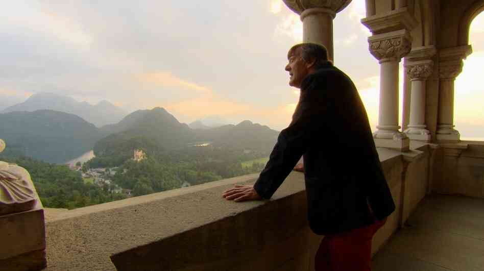 Stephen Fry takes in the view from Neuschwanstein Castle in Germany, one of the stops on a pilgrimage to explore his complicated feelings about the life and work of Richard Wagner.
