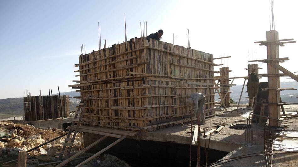 Workers construct new houses in the Jewish settlement of Shilo in the West Bank, back in February. (AFP/Getty Images)