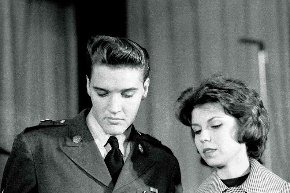"Elvis Presley, early 1960s, with Nancy Sinatra. ""I knew I would have to hustle in this competitive business if I wanted to make a name for myself .... But I had to make it to this one: Sgt. Elvis Presley, stationed for two years in Germany, was flying in to meet with the media at Fort Dix, N.J., on the eve of his discharge."""