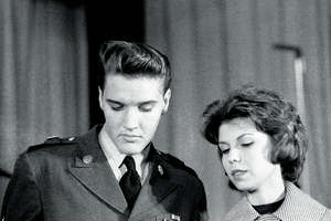 """Elvis Presley, early 1960s, with Nancy Sinatra. """"I knew I would have to hustle in this competitive business if I wanted to make a name for myself .... But I had to make it to this one: Sgt. Elvis Presley, stationed for two years in Germany, was flying in to meet with the media at Fort Dix, N.J., on the eve of his discharge."""""""