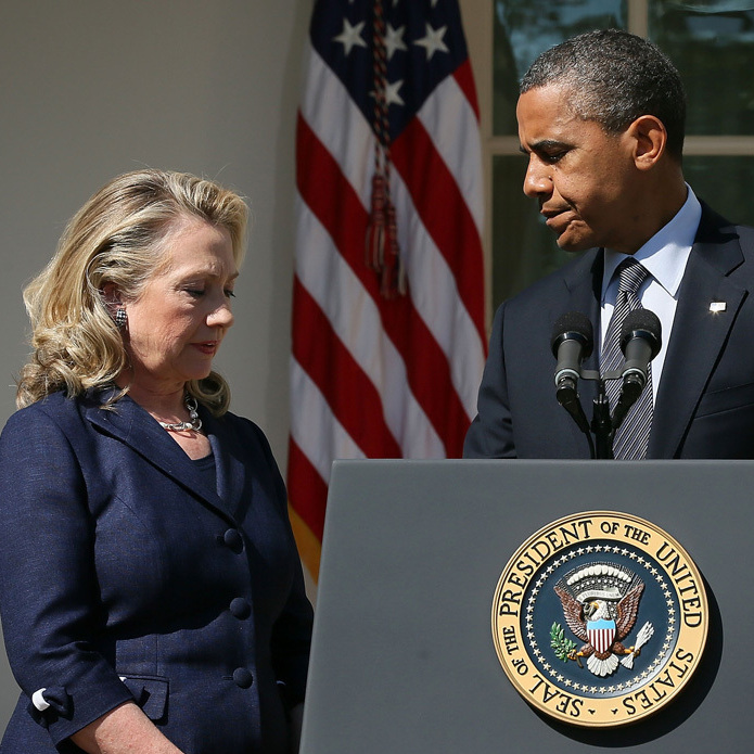 President Obama responds to the attack at the U.S. Consulate in Benghazi as Secretary of State Hillary Clinton looks on in the Rose Garden of the White House on Sept. 12.