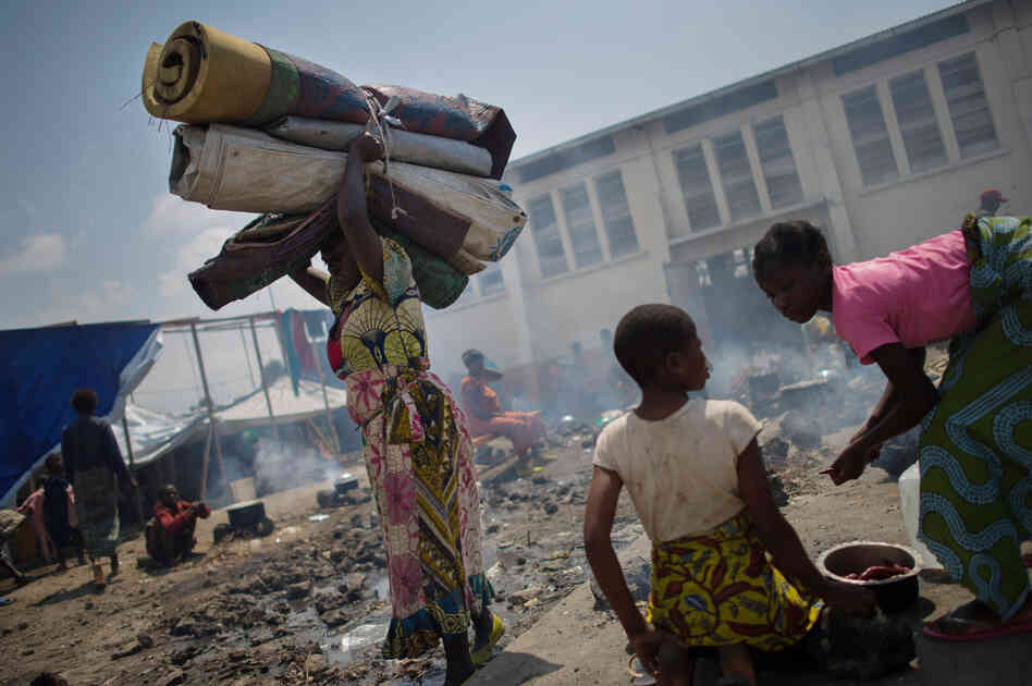 A displaced Congolese woman carries her belongings in the grounds of a religious organisation on the outskirts of Goma in the east of the Democratic Republic of the Congo, earlier this week.