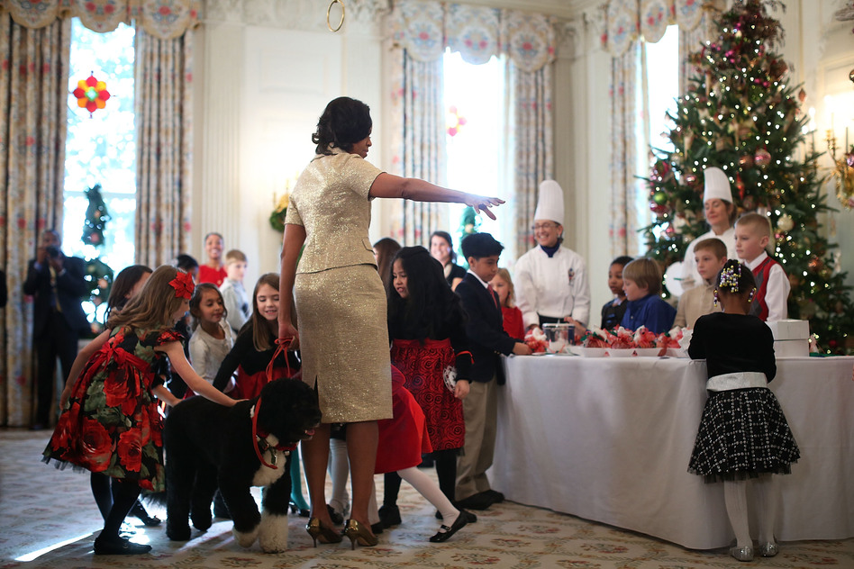 First lady Michelle Obama welcomed military families to the event. The guests' children got to pet the first family's dog, Bo.