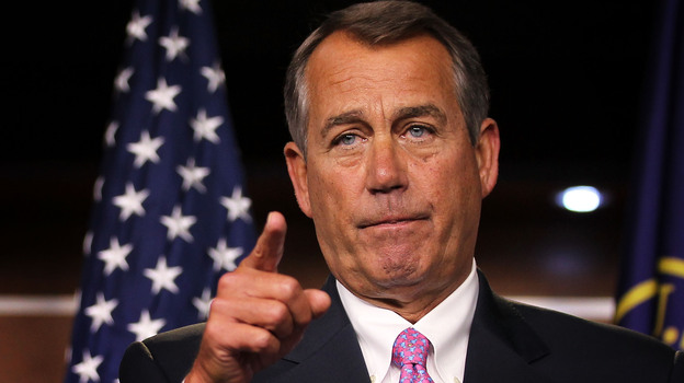 House Speaker John Boehner takes questions during a news conference Friday on Capitol Hill. (Getty Images)