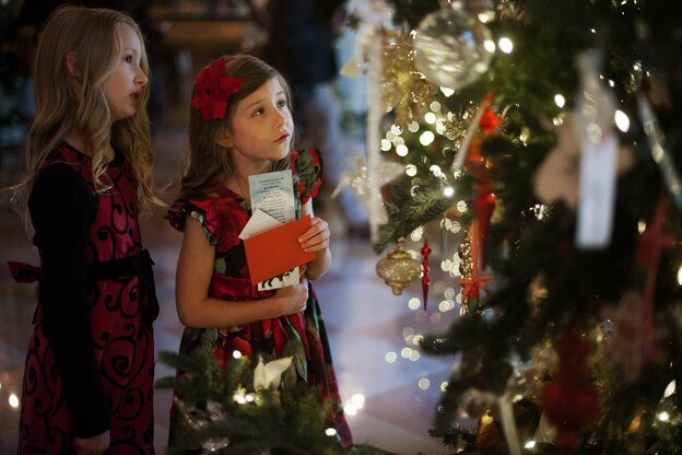 Lauren Rae (left) and Olivia Marlow look at the ornaments in the Grand Foyer during the first viewing of the White House 2012 holiday decorations in Washington, D.C., on Wednesday. This year's theme is