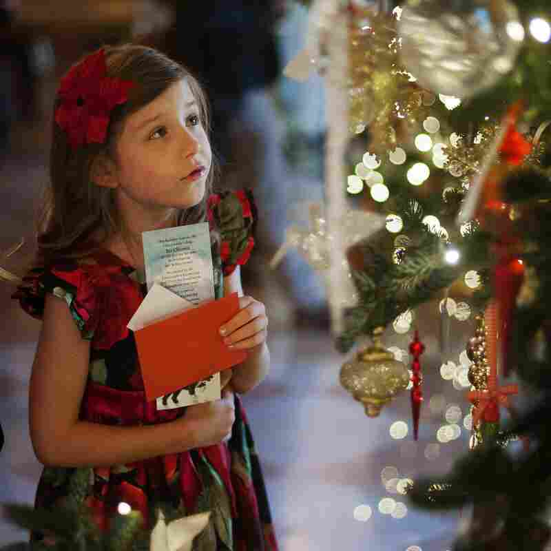 """Lauren Rae (left) and Olivia Marlow look at the ornaments in the Grand Foyer during the first viewing of the White House 2012 holiday decorations in Washington, D.C., on Wednesday. This year's theme is """"Joy to All."""""""