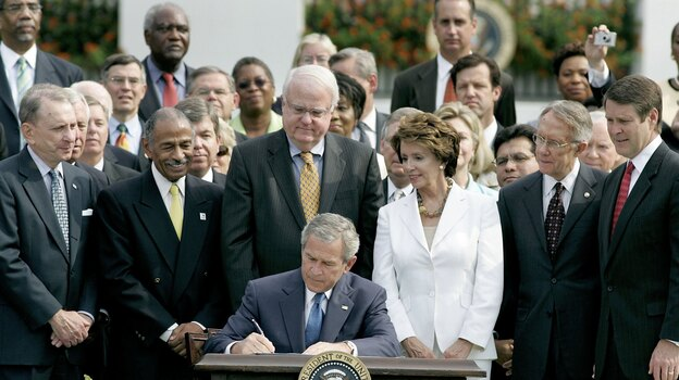 In 2006, then-President George W. Bush signs the reauthorization of the Voting Rights Act, on the South Lawn of the White House. (Getty Images)
