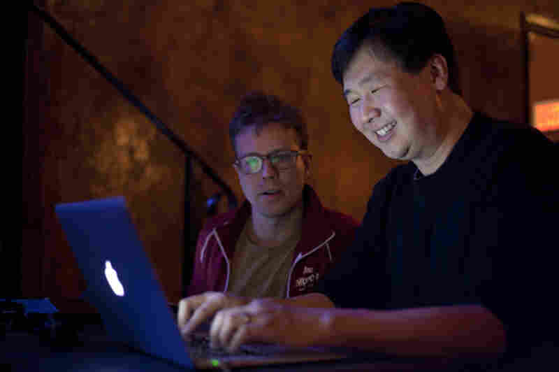 Puzzle Editor Art Chung (r) gets a laugh (perhaps at his own joke?) with Associate Producer Josh Rogosin (l) at the Nov. 26 taping.