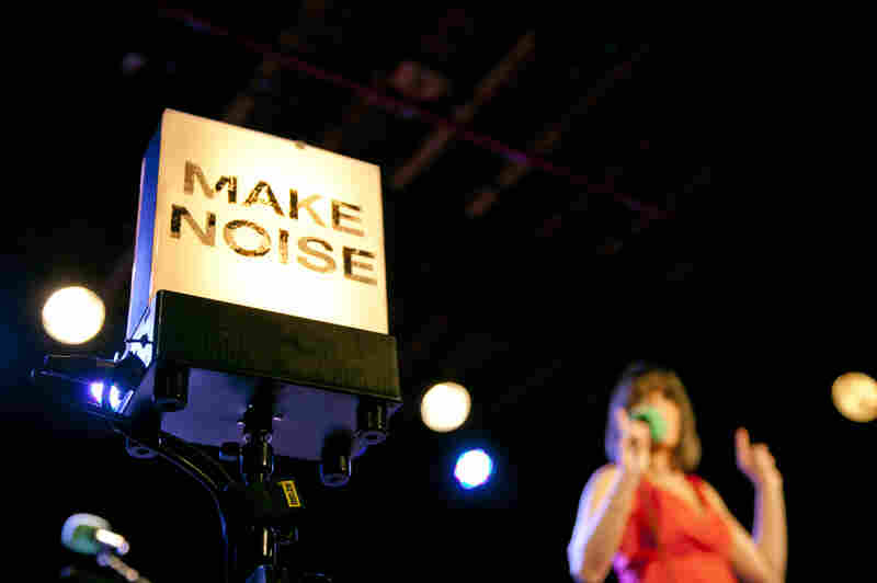 A telltale sign on the stage of 'Ask Me Another,' with Host Ophira Eisenberg doing her thing in the background.