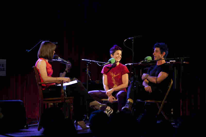 (l to r) 'Ask Me Another' Host Ophira Eisenberg interviews the night's special guests: The Acrobuffos, Big Apple Circus' clown team made up of married couple Christina Gelsone and Seth Bloom.