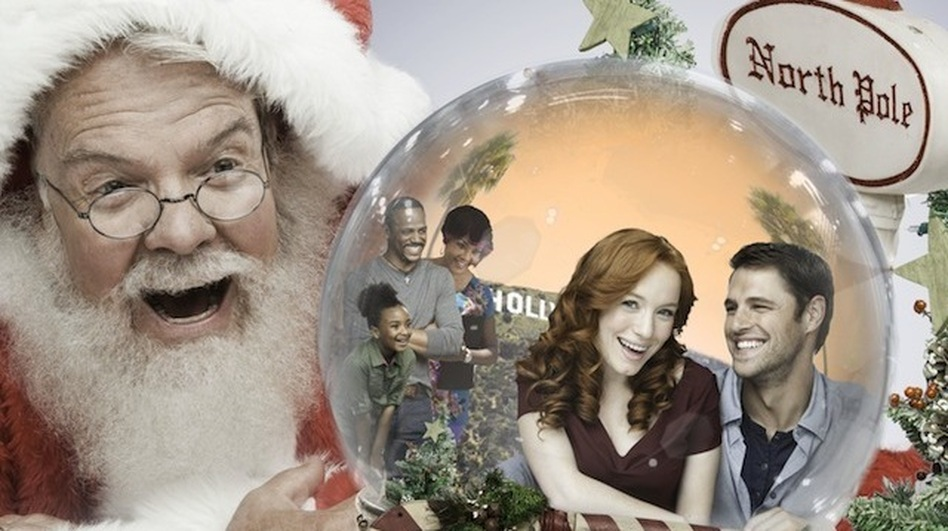 Why yes, this is a promotional image for a real holiday Hallmark movie called Annie Claus Is Comin' To Town. That's Annie Claus, Santa's daughter, inside the snow globe being stared at by her father. (Hallmark Channel)