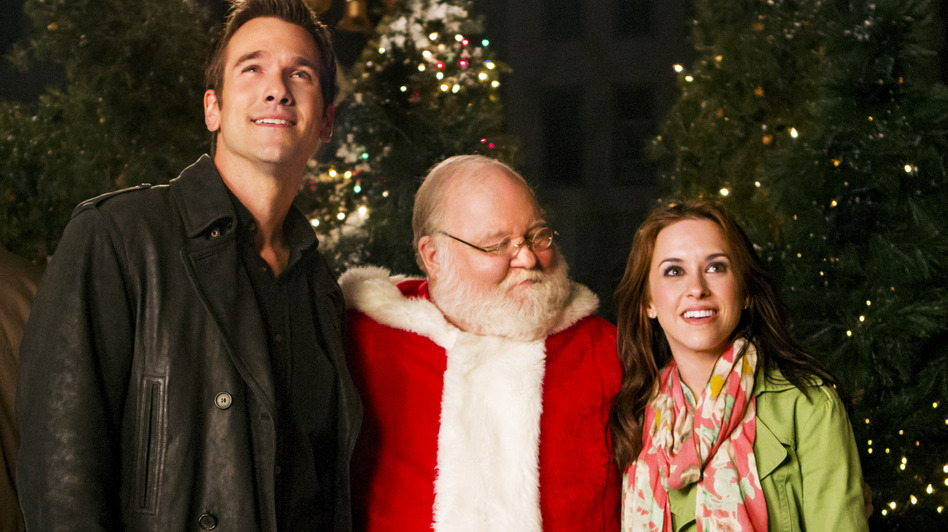 Matchmaker Santa is only one of many cornball films in which Santa (Donovan Scott) helps a woman (Lacey Chabert) find a boyfriend (Adam Mayfield). This is the one where the vanilla extract was key. (Hallmark Channel)
