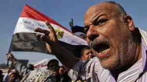 A protester shouts early Friday in Cairo's Tahrir Square.