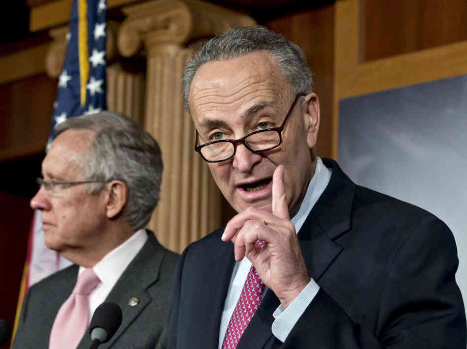 Sen. Charles Schumer, D-N.Y. (right), shown at a news conference Thursday on Capitol Hill with Senate Majority Leader Harry Reid, is argui