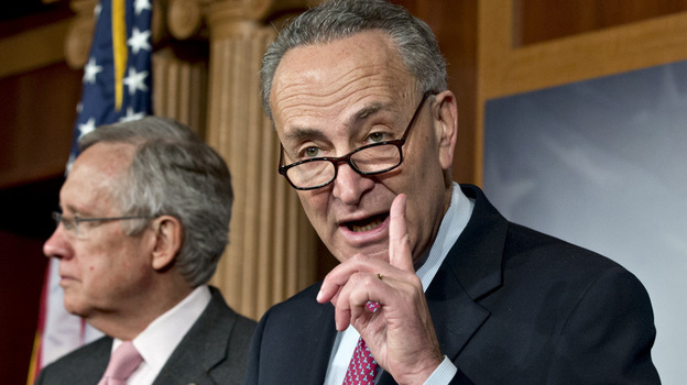 Sen. Charles Schumer, D-N.Y. (right), shown at a news conference Thursday on Capitol Hill with Senate Majority Leader Harry Reid, is arguing for raising taxes on the wealthy as part of a deal to avoid the fiscal cliff. (AP)