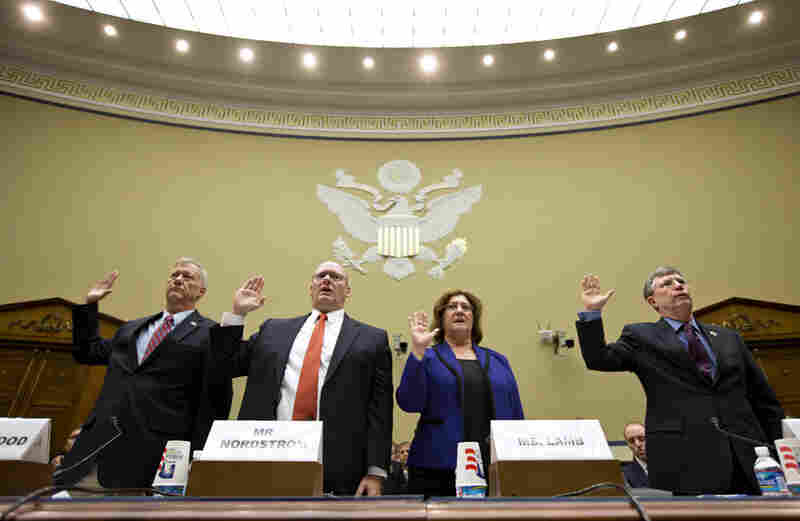 Witnesses are sworn in on Capitol Hill on Oct. 10, before testifying at a House Oversight and Government Reform Committee hearing on the attack on the U.S. Consulate in Benghazi, Libya.