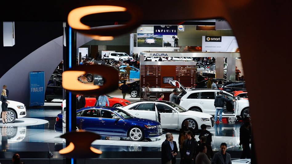 Attendees walk through the Los Angeles Convention Center floor during the L.A. Auto show on Nov. 29. Technology is taking the idea of working from the road to a whole new level. (Getty Images)