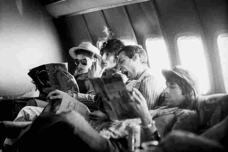 Tour of the Americas, on the plane between San Antonio and Kansas City,June 1975, (left to right) Bianca Jagger, Ron Wood, Charlie Watts and Keith Richards.