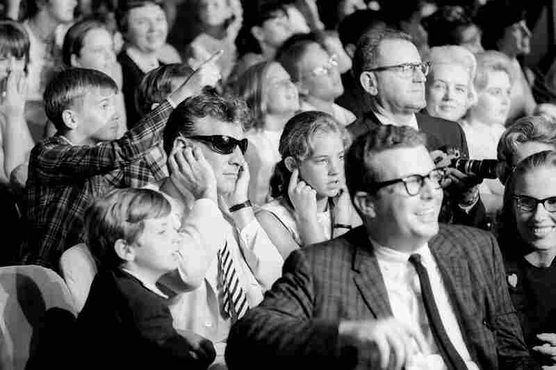 """""""When The Beatles returned to America in August, 1965 ... I got one of my favorites. Walking the aisles, one audience member caught my eye: an older man sitting with his fingers plugged in his ears to mute the high-pitched squeals. As I moved in for this terrific shot, I got a closer look and realized I was photographing the legendary composer and conductor Leonard Bernstein."""""""