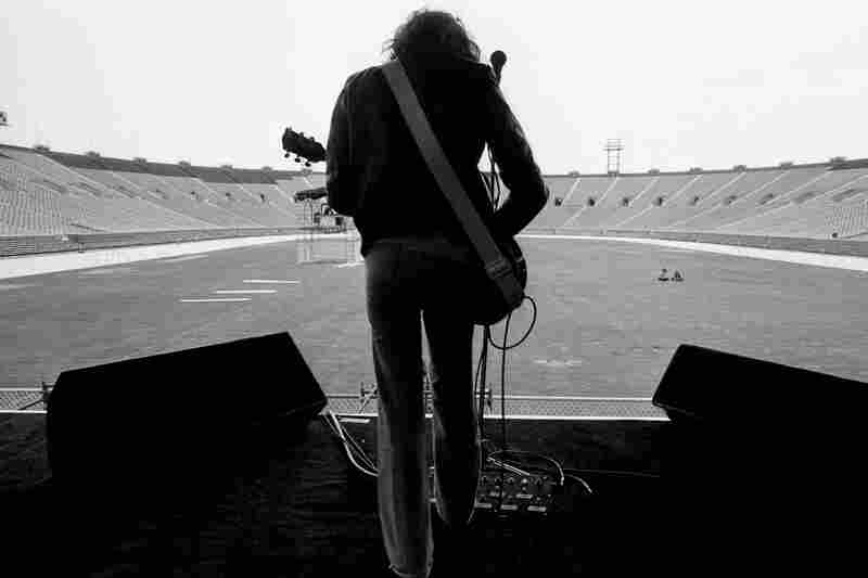 """In 1977, Peter Frampton was filling 90,000-seat stadiums as a good-looking songwriter and fluid, blues-rock guitarist who made upbeat lollipop rock. I shot him in several situations ... [including] at a sold-out concert in Philadelphia's JFK Stadium."""