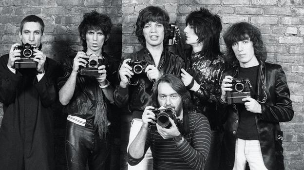 Photographer Ken Regan with the Rolling Stones, 1977 (Courtesy of Ken Regan/Camera 5)
