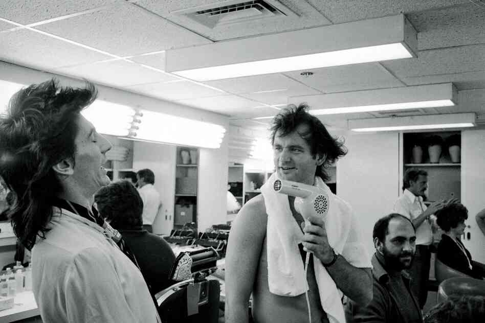 The Rolling Stones on Saturday Night Live, 1978. Bill Murray blow-drying Ron Wood's hair.