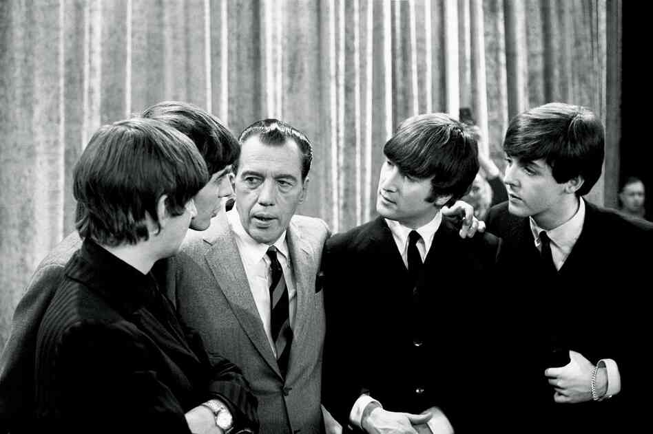 "The Beatles with Ed Sullivan, 1964. ""The audience in the 703-seat theater shrieked nonstop. This was at the deafening dawn of Beatlemania. You couldn't hear a thing. Some fans just seemed to be in shock, staring ahead, tears running down their cheeks."""