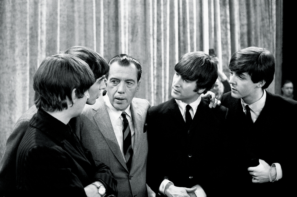 "The Beatles with Ed Sullivan, 1964. ""The audience in the 703-seat theater shrieked nonstop. This was at the deafening dawn of Beatlemania. You couldn't hear a thing. Some fans just seemed to be in shock, staring ahead, tears running down their cheeks."" (Ken Regan)"