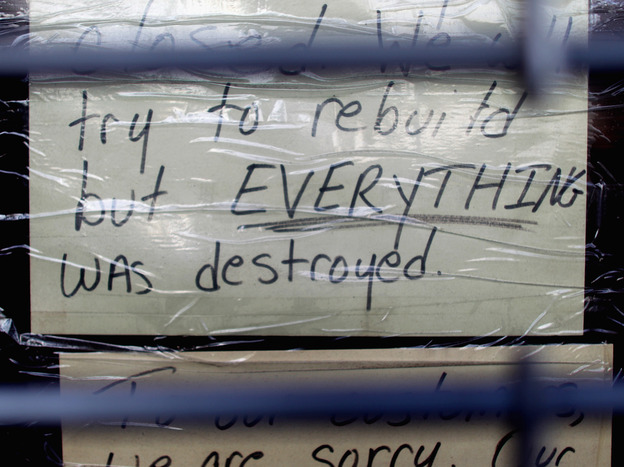 Nov. 17: A sign in a Staten Island storefront tells a lot. It was still closed because of the damage done by Superstorm Sandy in late October.