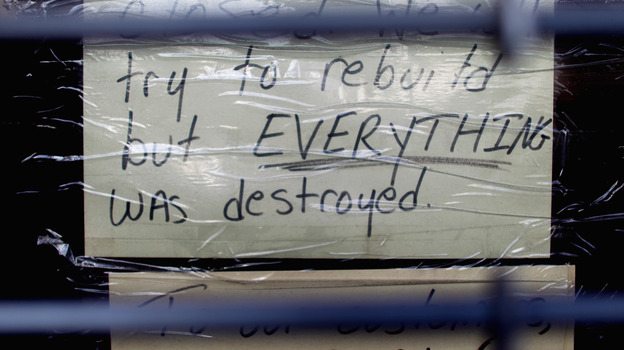Nov. 17: A sign in a Staten Island storefront tells a lot. It was still closed because of the damage done by Superstorm Sandy in late October. (Getty Images)