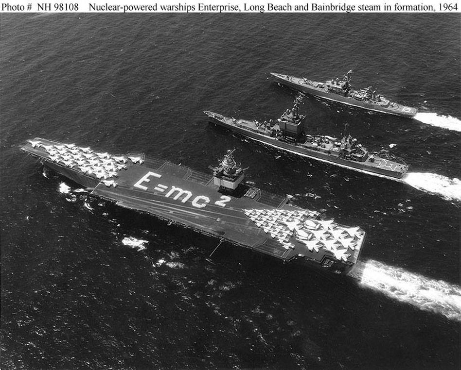 Occasionally members of Enterprise's crew create flight formations to commemorate important dates or events. In 1964 they spelled out Albert Einstein's most famous equation. (U.S. Navy)