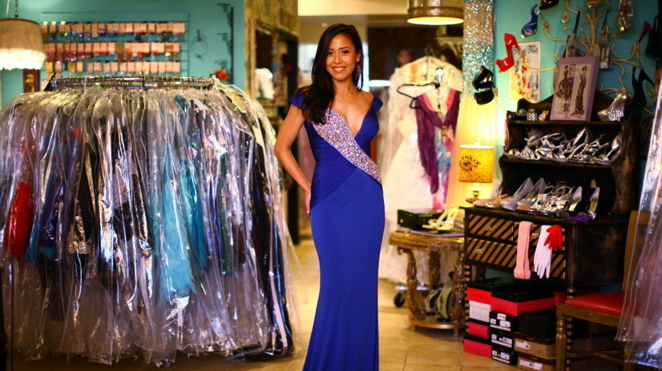 Jessica Bermudez, 24, models a dress at Deja Vu in Alexandria, Va. Bermudez is competing for the title of Miss District of Columbia USA, and says she regularly enters beauty pageants. (NPR)