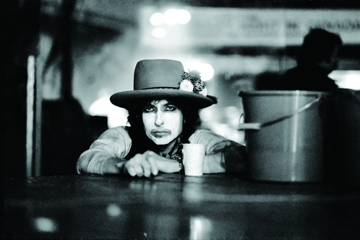 "Rolling Thunder Revue tour, Montreal, 1975. ' ""What's with the whiteface?"" I asked Bob as he was being made up before a show. Nobody could figure that out. He said, ""Well, I'm playing these halls and it's really dark. I want the people way in the back to be able to see my eyes."" Okay. Whatever."""