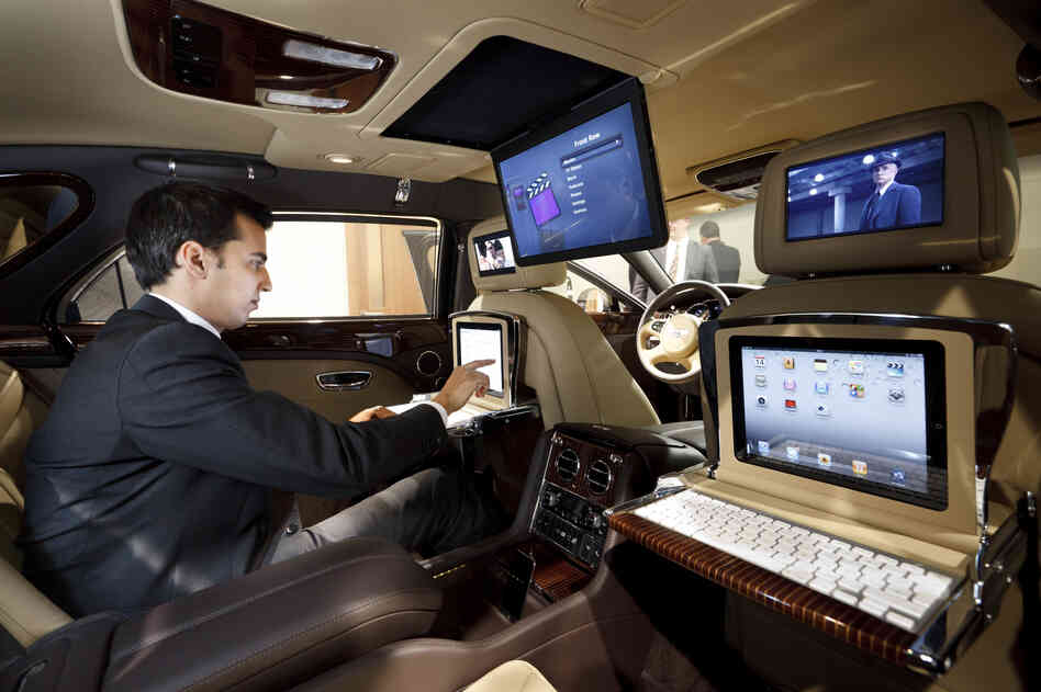 The 2013 Bentley Mulsanne features drop-down iPad workstations. More cars are being outfitted to operate as mobile offices.