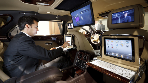 The 2013 Bentley Mulsanne features drop-down iPad workstations. More cars are being outfitted to operate as mobile offices. (Bentley Motors)