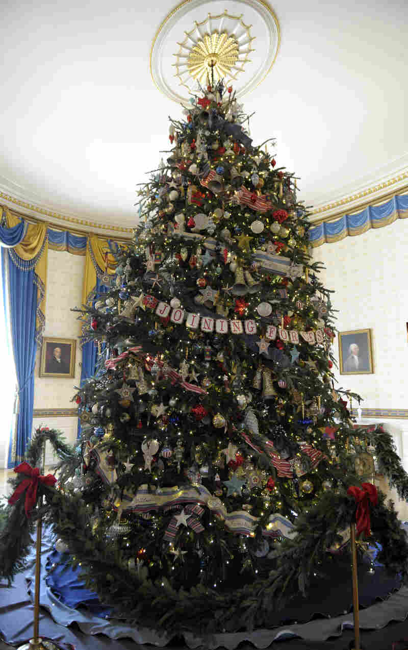 The official White House Christmas tree, an 18-foot-6-inch Frasier fur from Jefferson, N.C., was adorned with ornaments decorated by military children living on bases all over the world.