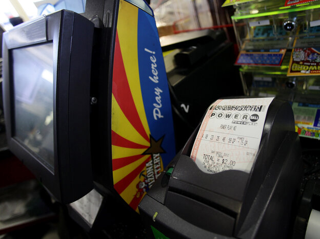 A Powerball lottery ticket sits in the machine at the 4 Sons Food Store and Chevron gas station which sold one of two winning Powerball lottery tickets in Fountain Hills, Ariz.