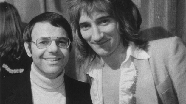 Joe Smith poses with Rod Stewart, circa 1974. The former record executive conducted informal interviews with dozens of musicians in the mid-1980s. (Jeff Smith)