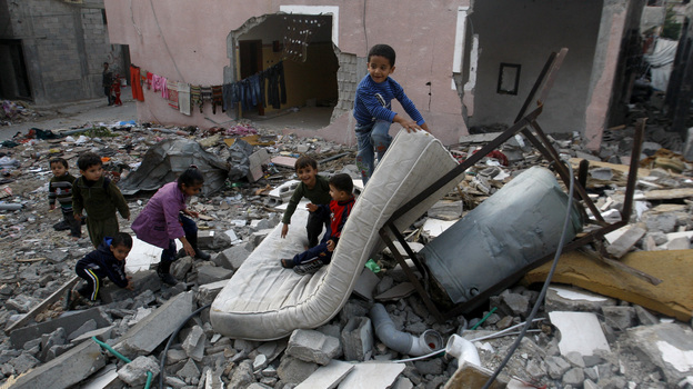 Palestinian children play in the rubble of a house that was hit by an Israeli strike during Israel's recent military offensive in the Gaza Strip Saturday. (AP)