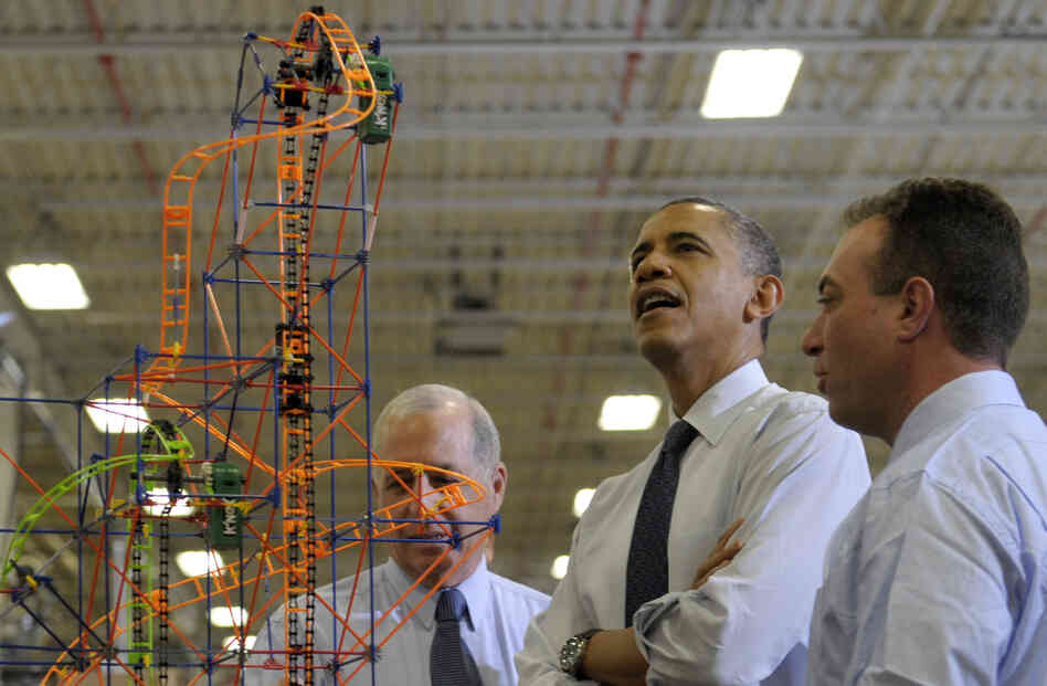 President Obama looks over a roller coaster with K'Nex inventor and Chairman Joel Glickman (left) and President and CEO Michael Araten on Friday during a tour of the